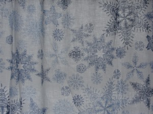 I celebrate January with snowflake curtains in my dining room!