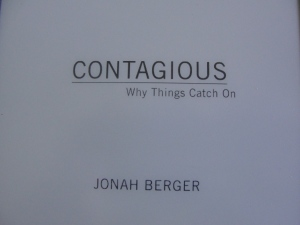 Reading Contagious: Why Things Catch On on my Kindle!