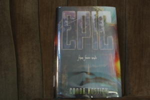 """Epic,"" by Conor Kostick, in a nice shiny library protective page. :) Take a closer look at the book  on Amazon.com."
